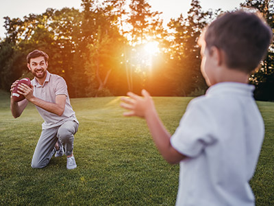 Father and Son Playing Catch After Defeating Prostate Cancer